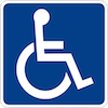 Handicapped Accessible Sign featuring a white wheelchair symbol  on a blue background